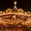 Stock Photo: Children Merry-go-round at Christmas Market in Dresden
