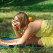 Girl with orange yoga outdoors — Stock Photo