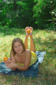 The girl on the nature with oranges — Stock Photo