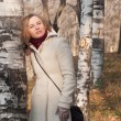 Foto Stock: Girl against birches