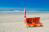 Chaise lounges on an ocean coast — Stock Photo