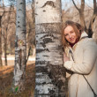 Girl and birch — Stock Photo