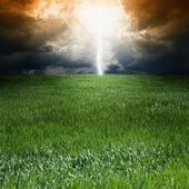 Storm, green field — Stock Photo