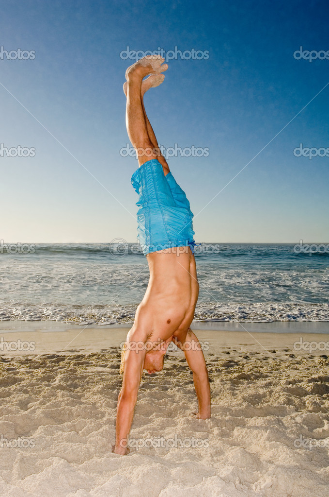 Young man doing a handstand  Stock Photo #7030193
