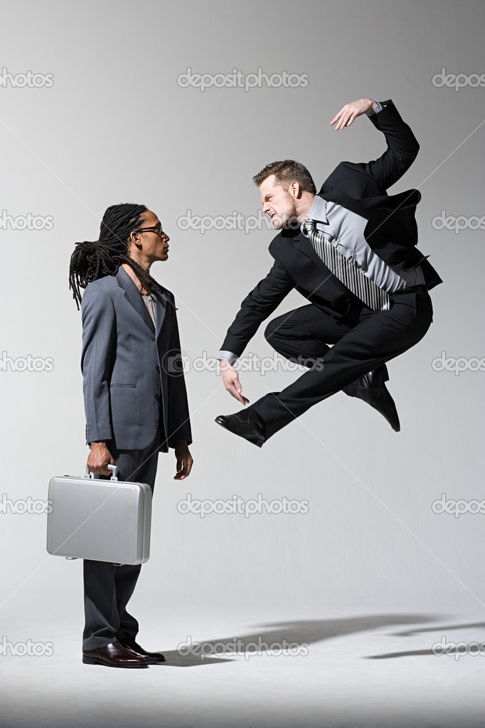 A man scaring another man  Stock Photo #7037114