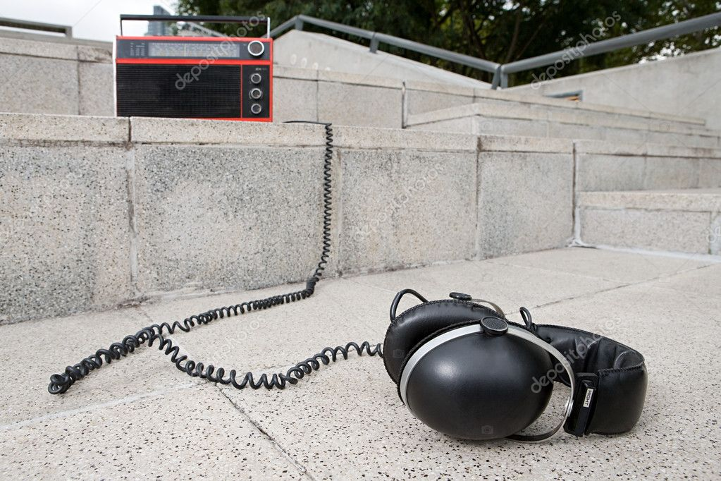 Headphones and radio on concrete steps  Stock Photo #7037549