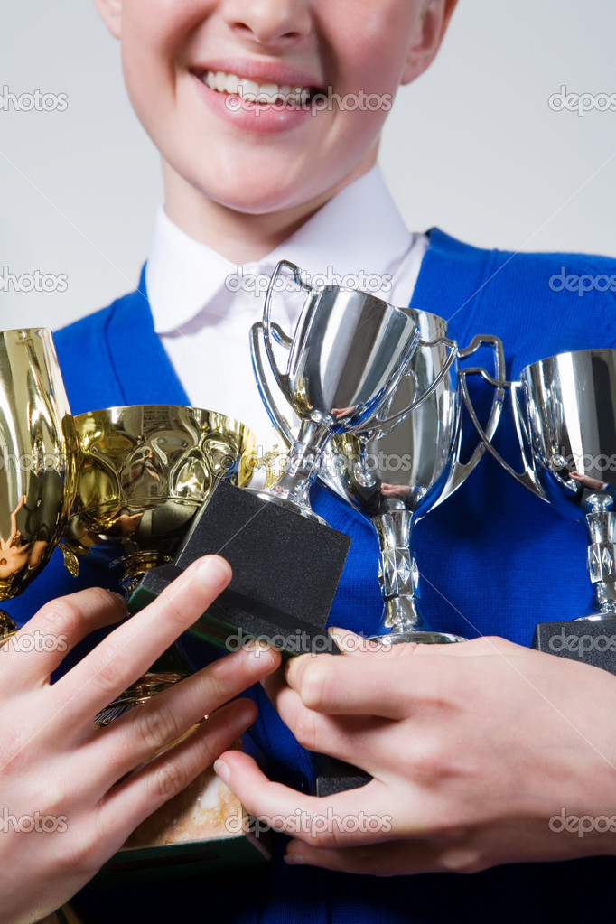 Girl holding trophies — Stock Photo #7038536