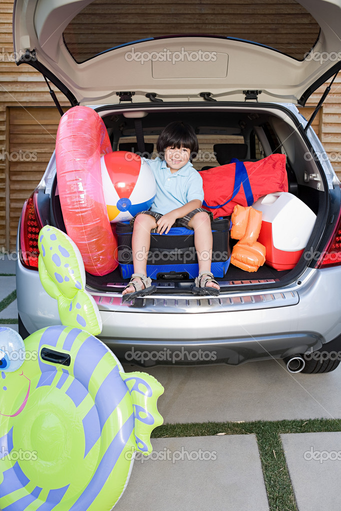 Boy in a car boot  Stock Photo #7039187
