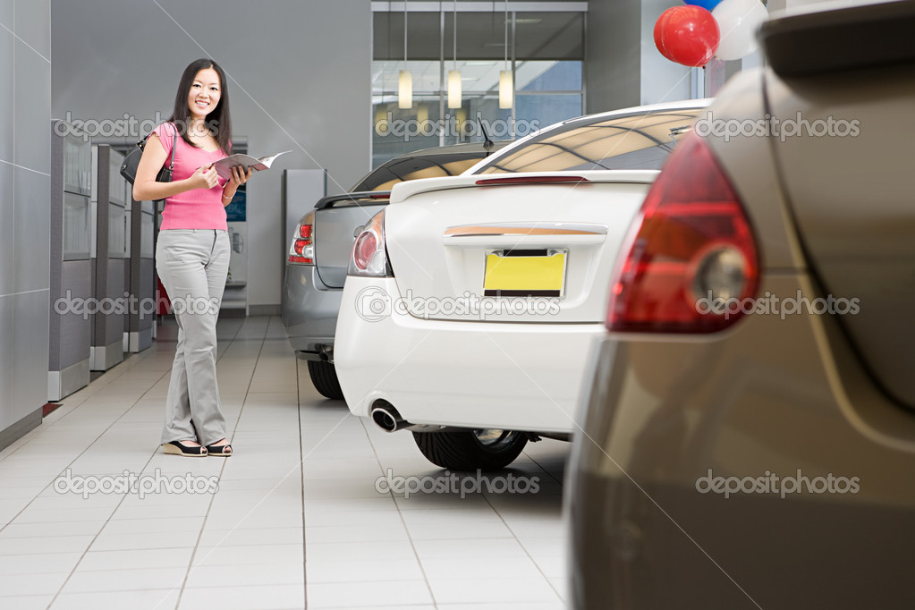 Woman in car dealership — Stock Photo #7039202