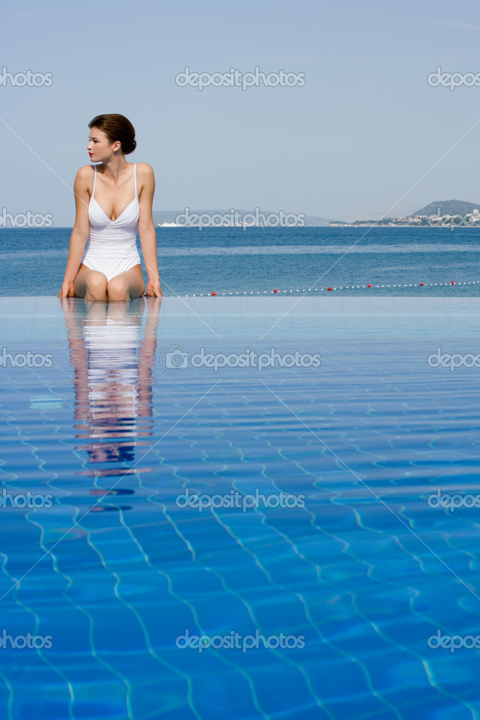 Young woman in infinity pool  Stock Photo #7039749