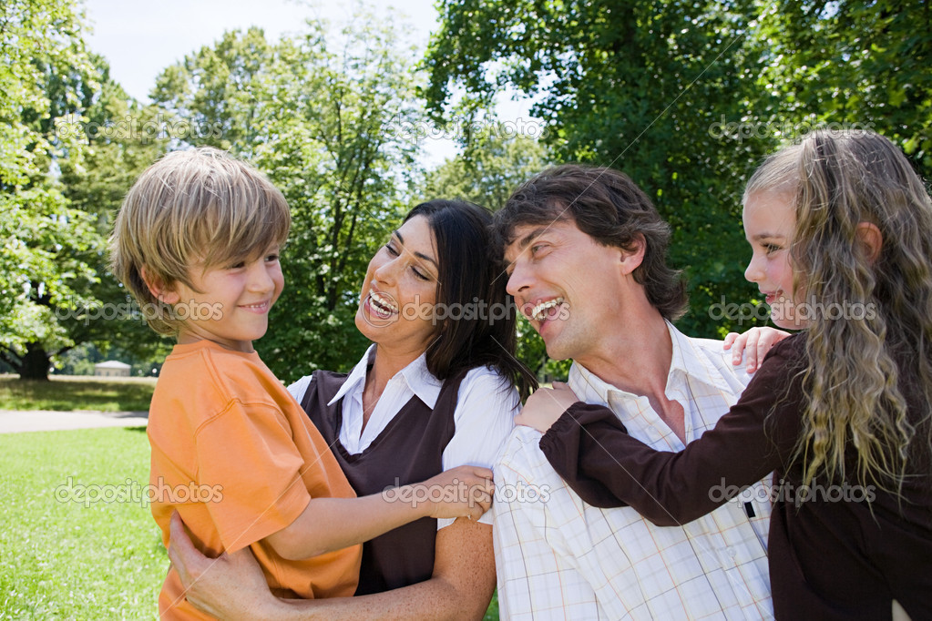 Happy family in park  Stock Photo #7044907