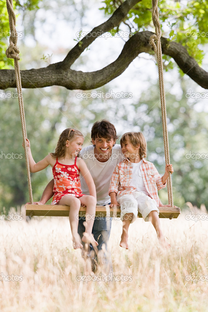 Children on swing with father — Lizenzfreies Foto #7044919