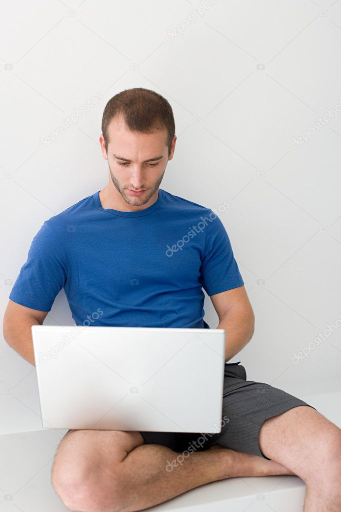 Young man using laptop — Stock Photo #7044943
