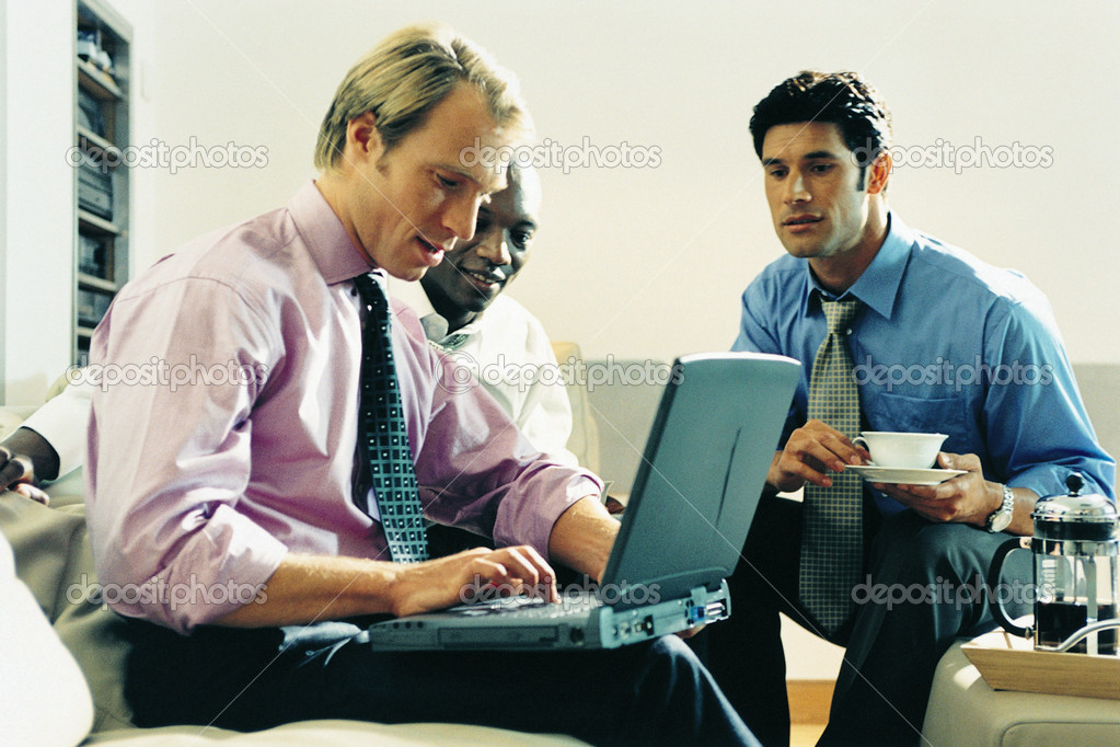 Businessmen in meeting  Stock Photo #7046076