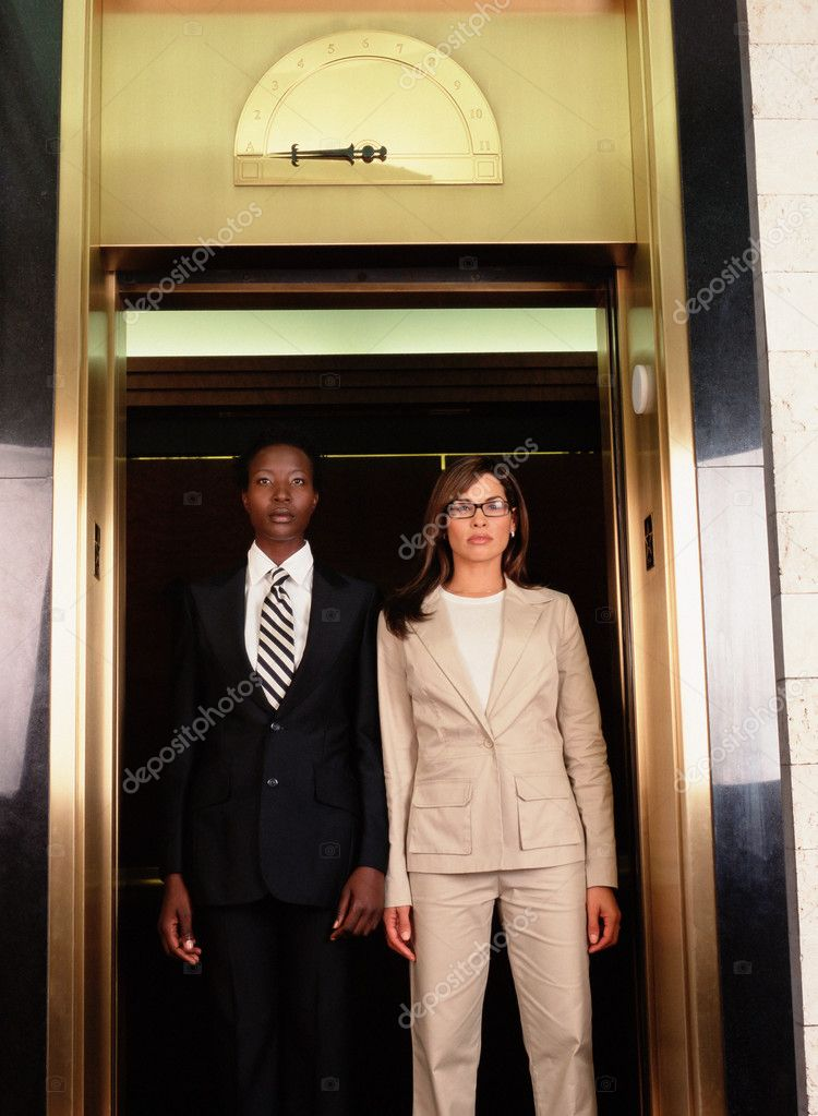 Businesswomen in elevator  Stock Photo #7048768