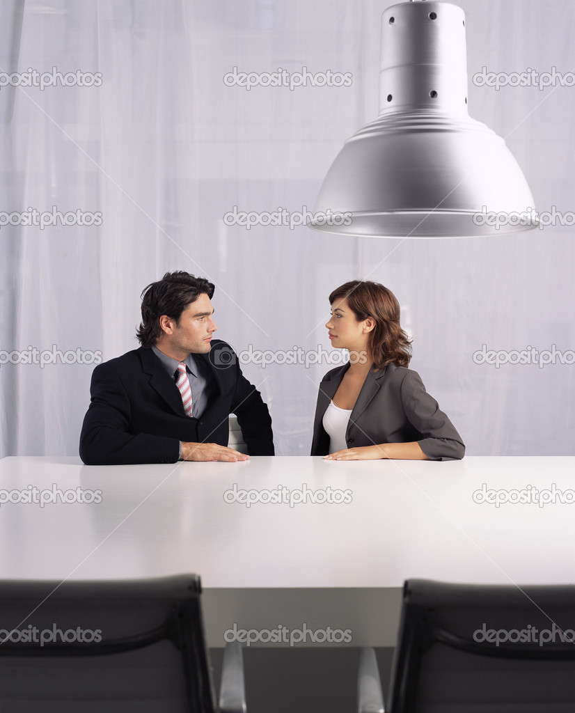 Businessman and businesswoman staring at each other — Stock Photo #7049144
