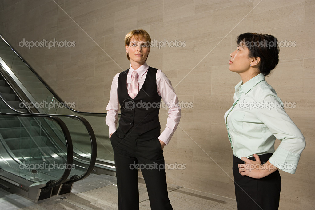 Businesswomen by escalator  Stock Photo #7049798