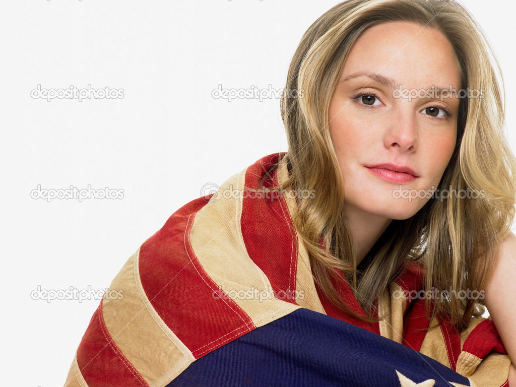 Woman wrapped in a flag — Stock Photo #7057961