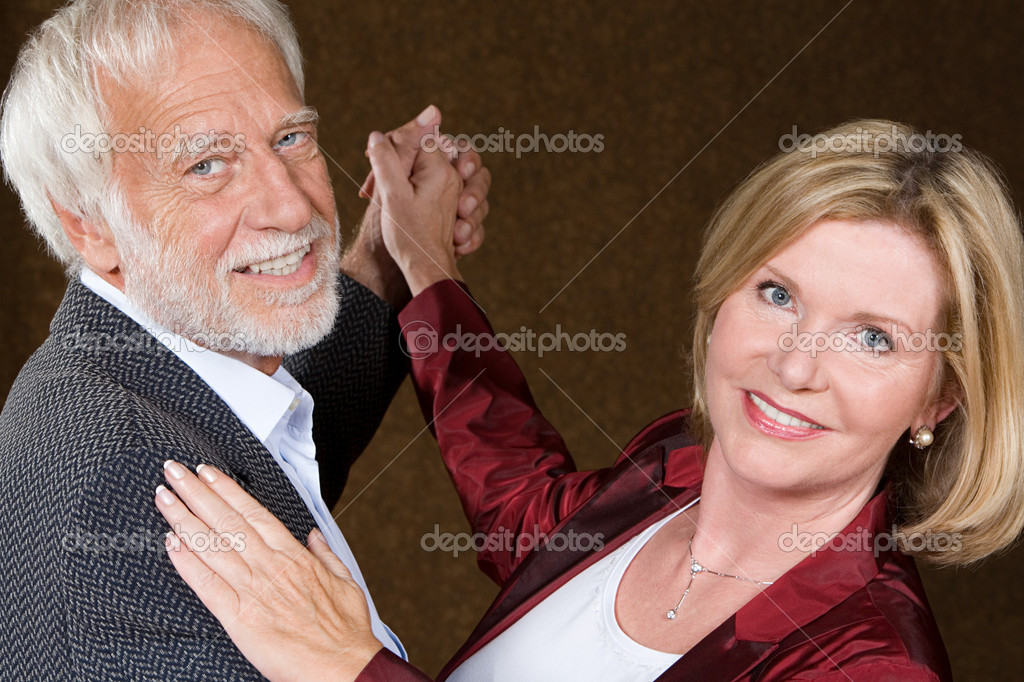 Senior couple dancing  Stock Photo #7058156