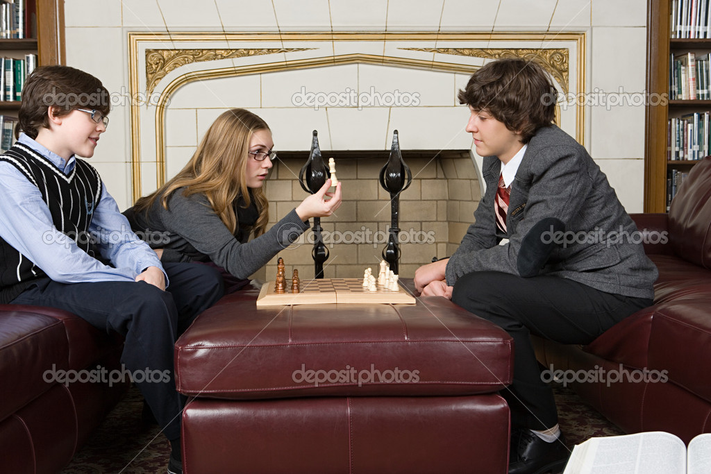 Teenagers playing chess — Stock Photo #7059264