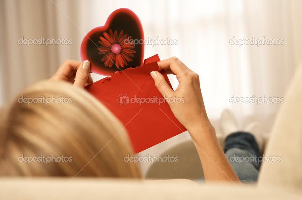 Woman holding a valentines card — Photo #7064213