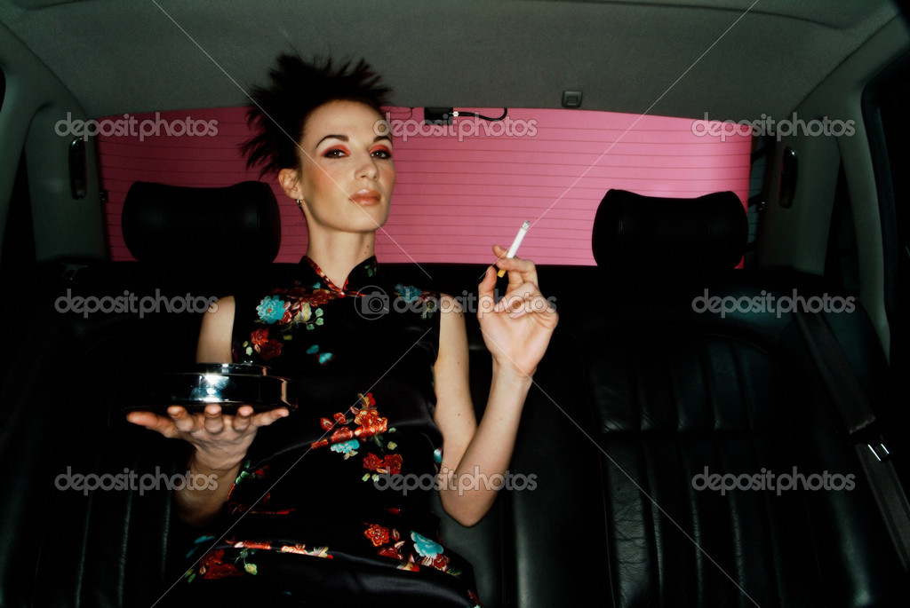 Woman smoking in car — Stock Photo #7064979