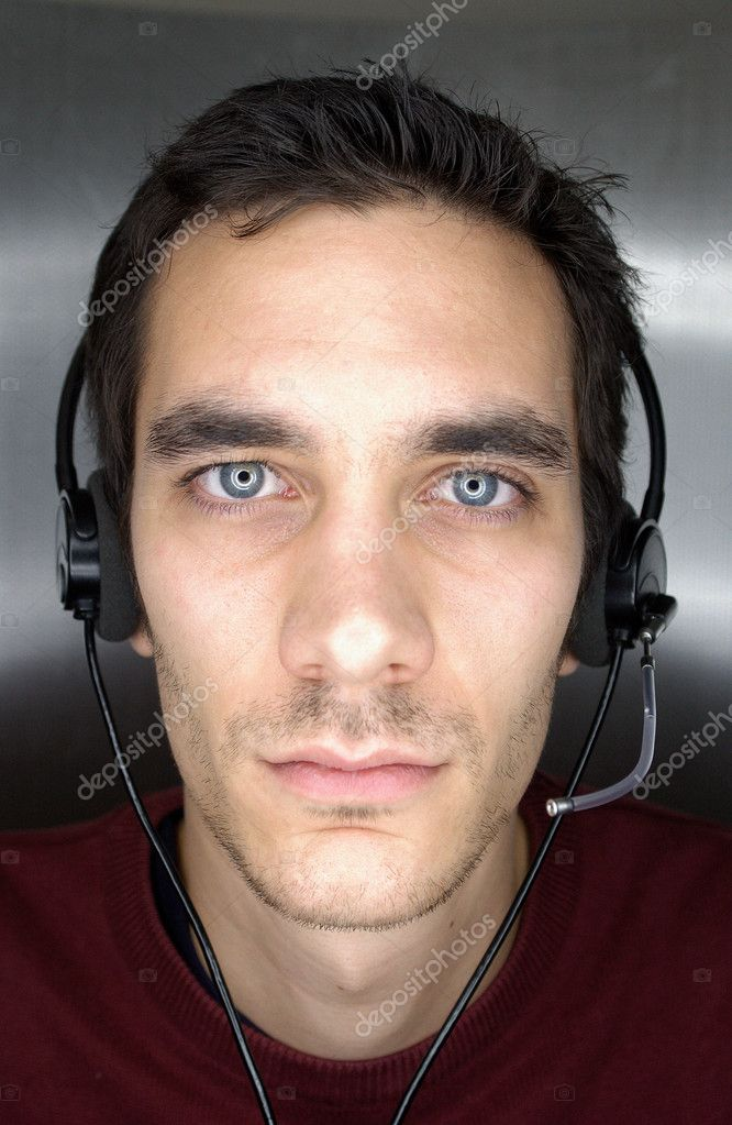 Young man wearing a telephone headset — Stock Photo #7066683
