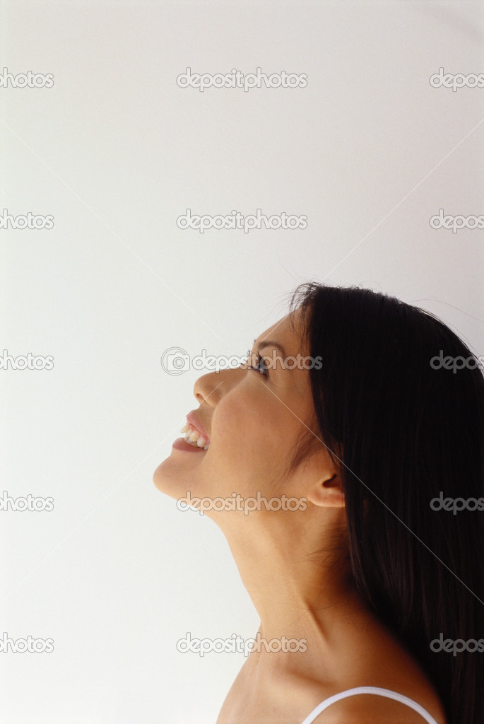 Profile of a smiling woman — Stock Photo #7067618