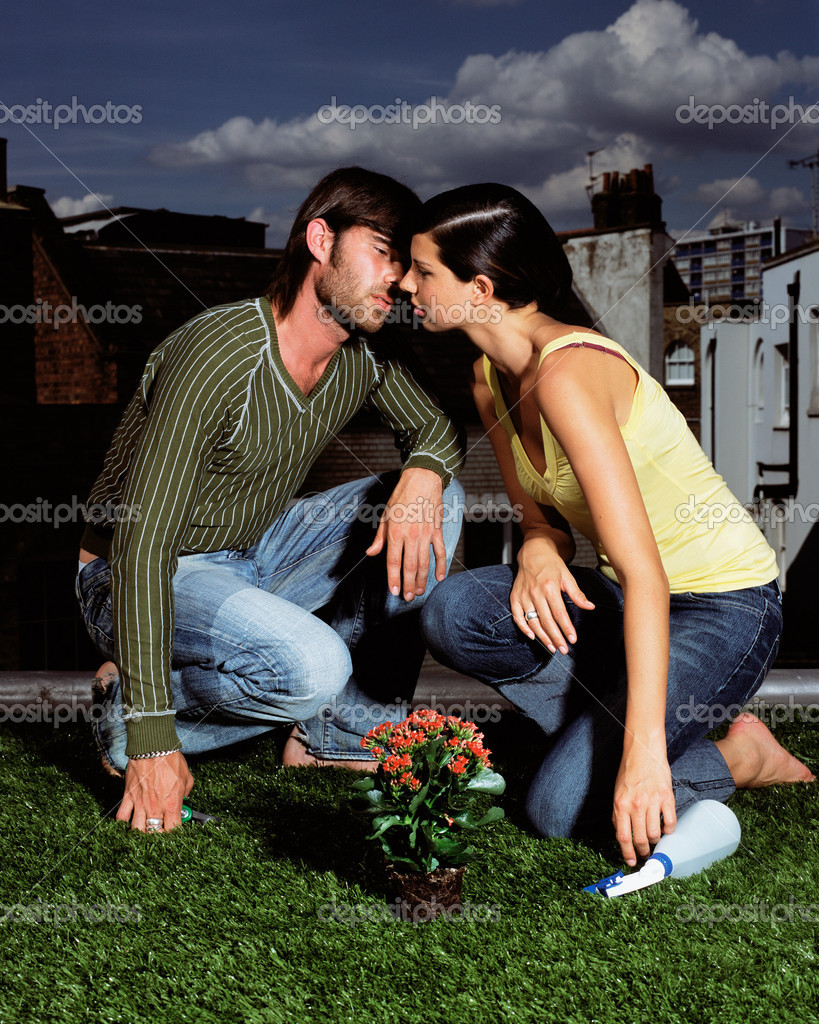 Affectionate couple in roof garden — Stock Photo #7067910