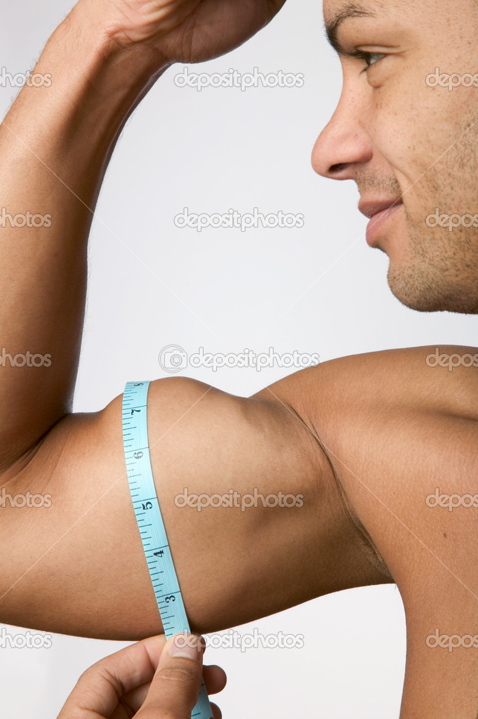 Man measuring his arm muscle — Stock Photo #7068507