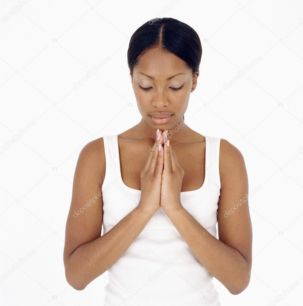 Young woman praying — Stock Photo #7068819