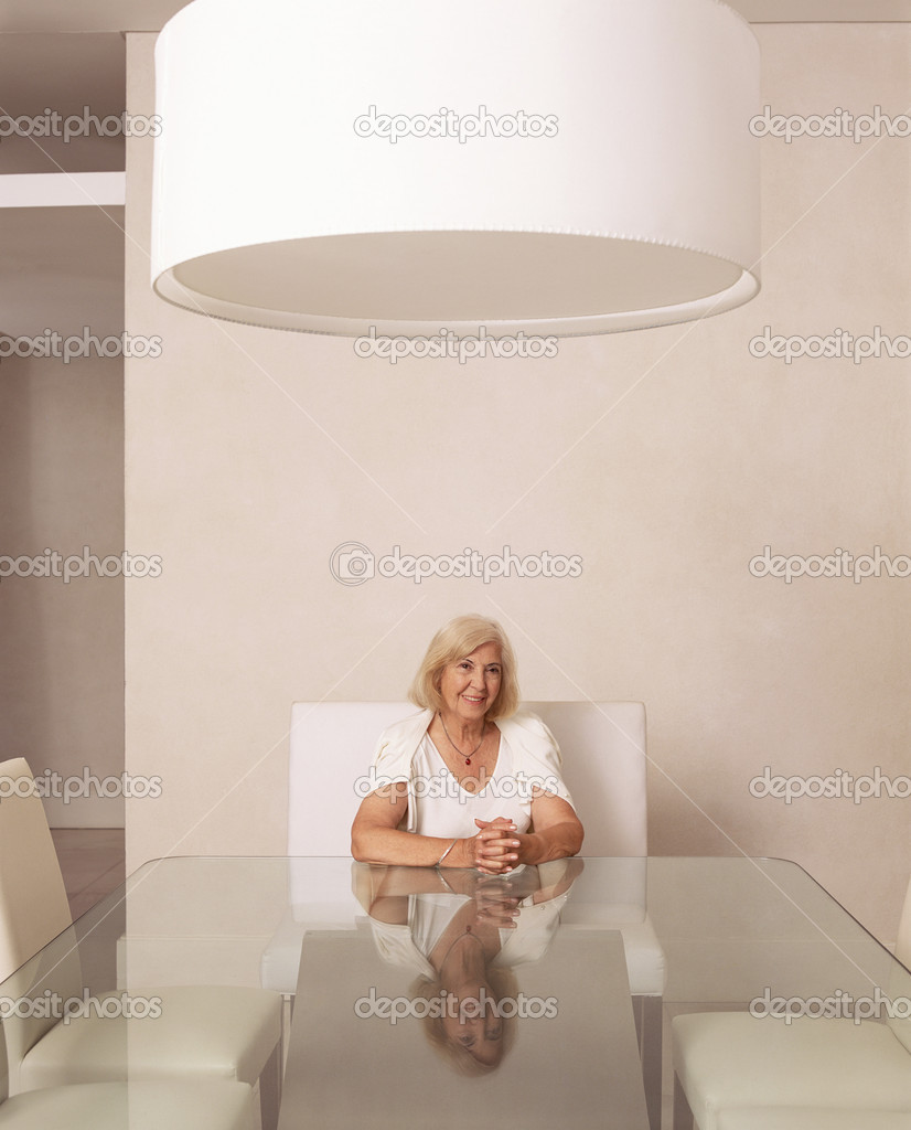 Senior woman sitting in stylish dining room — Stock Photo #7068942