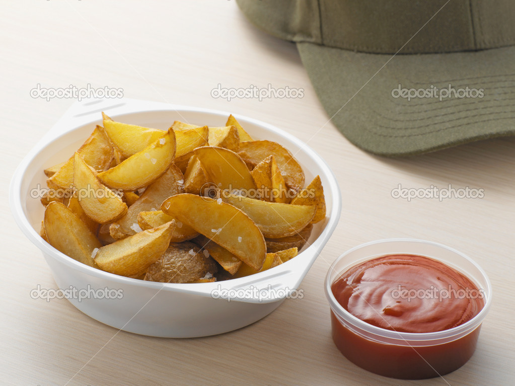 Potato wedges and a baseball cap  Stock Photo #7071119