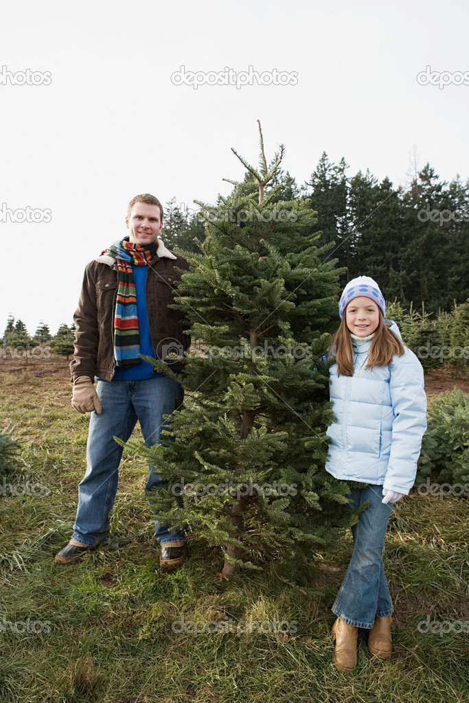 Dad and daughter with christmas tree  Stock Photo #7071326