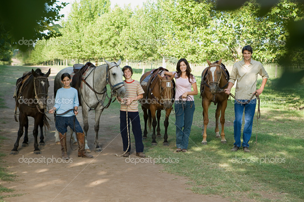 Family with horses — Stock Photo #7071527