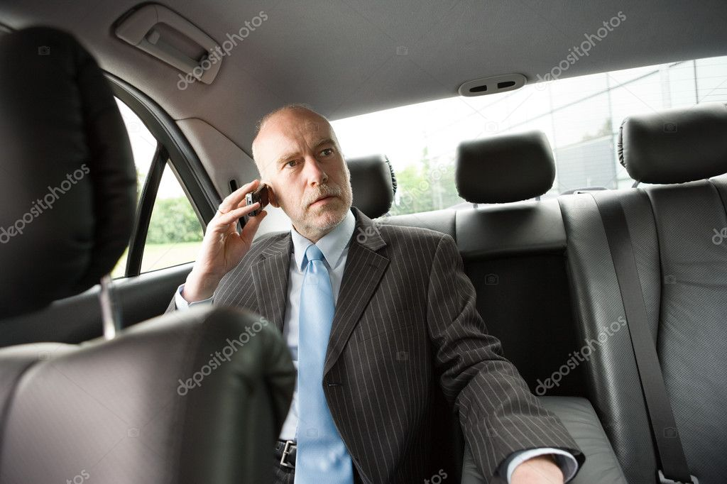 Businessman on phone sitting in car — Stock Photo #7072508