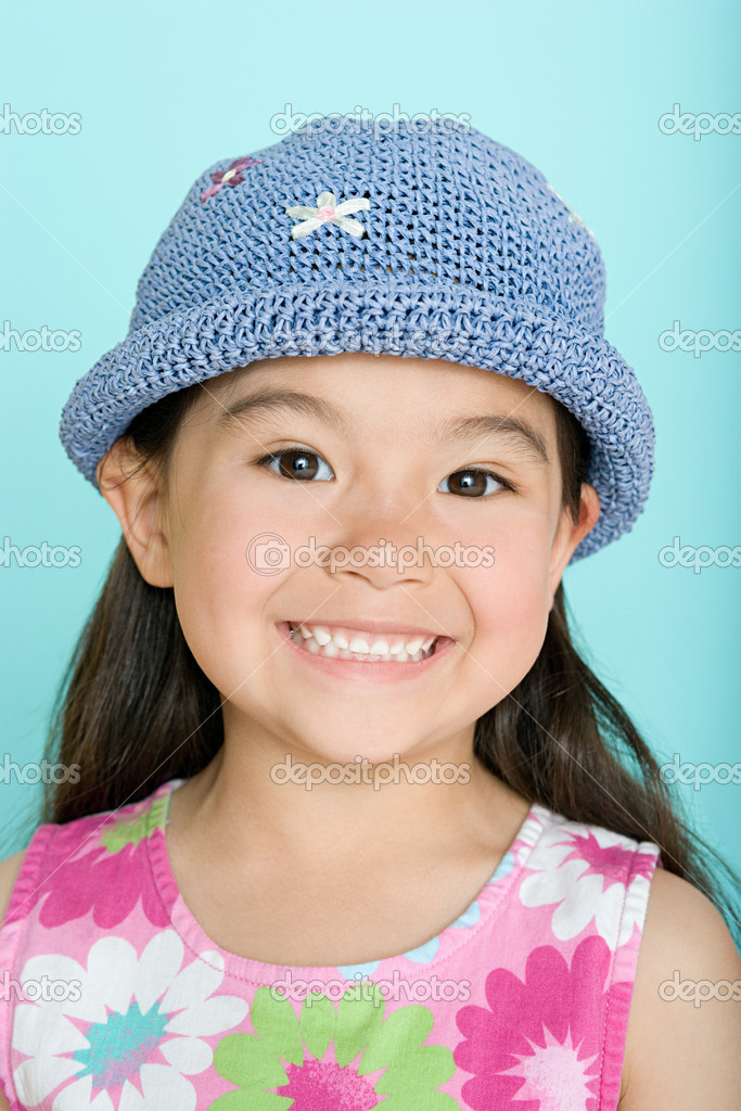 Portrait of a smiling asian girl  Stock Photo #7073426