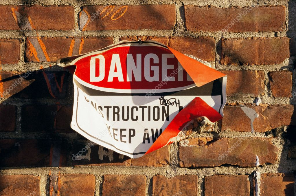 Danger sign on a wall — Stock Photo #7078073