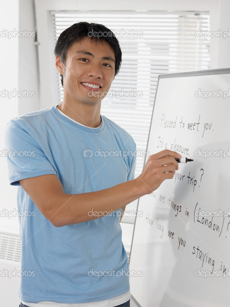 Student writing on whiteboard  Stock Photo #7079198