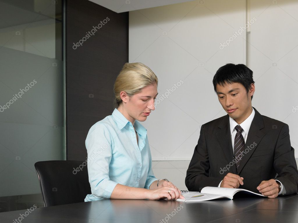 Two colleagues reading textbook — Stock Photo #7079216