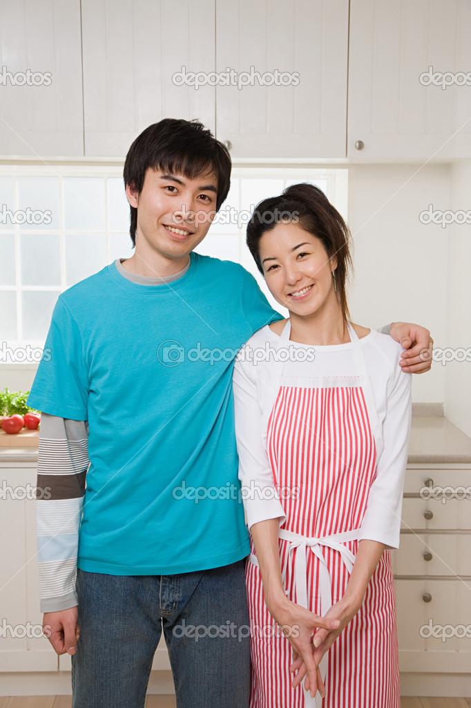 Couple in their kitchen  Stock Photo #7080628