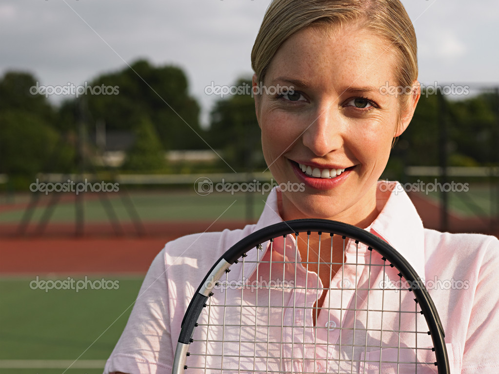 Girl holding a tennis racket  Stock Photo #7081764