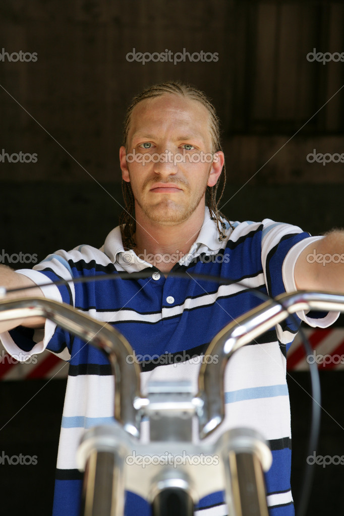Young man on bike — Stock Photo #7082889
