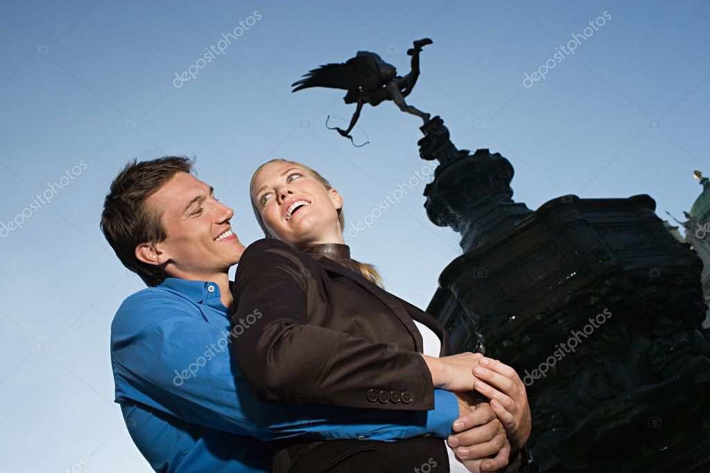 Couple hugging under Eros statue  Stock Photo #7083736