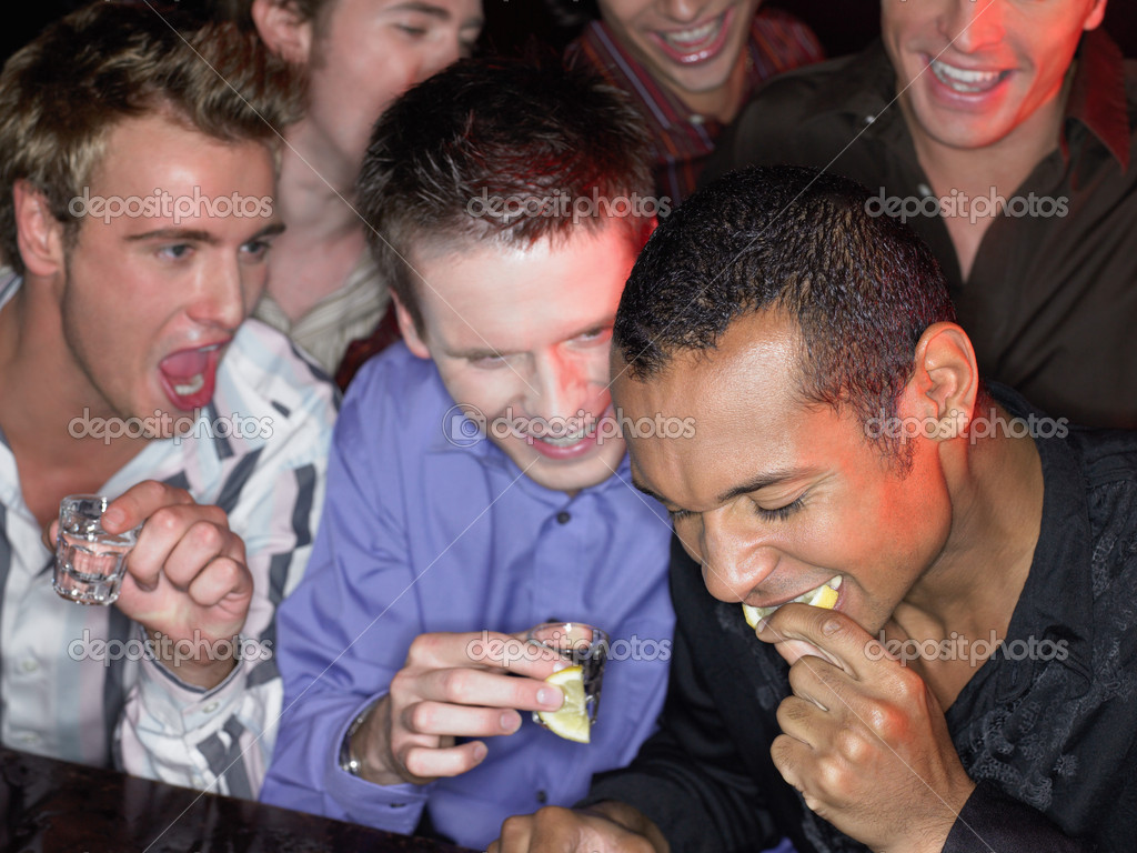 Men drinking shots at a bar — Stock Photo #7083978
