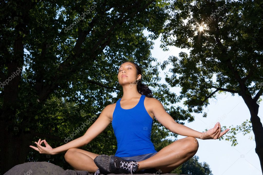 Woman meditating under trees — Stock Photo #7084057