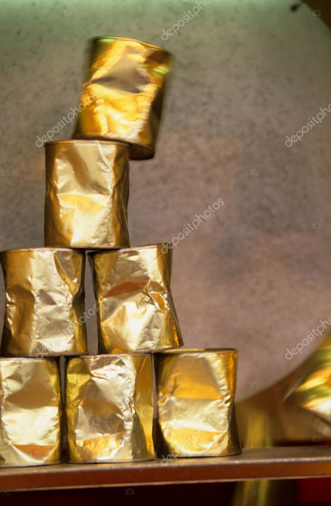 Stack of golden cans at fun fair — Stock Photo #7084427