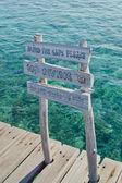 Danger wooden sign on Maldivian jetty — Stock Photo