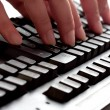 Typing fingers on a keyboard — Stock Photo