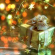 Stock Photo: Gift box and twinkle lights.